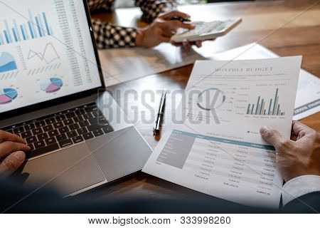 Teamwork of business colleagues, consultation new strategy plan business and market growth on financial document graph report, conference to making growth profit, Partner meetings and briefing. stock photo