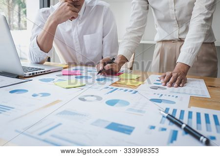 Two business colleague meeting to brainstorm the new project business strategy plan and analysis data document, finance and accounting concept Briefing, brainstorming, consulting. stock photo