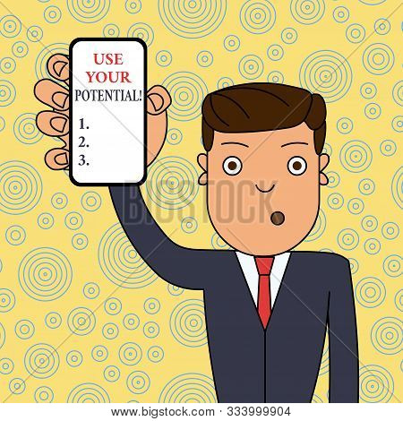 Word writing text Use Your Potential. Business concept for achieve as much natural ability makes possible Man Holding Vertically Smartphone Device with Blank Screen for Attention. stock photo