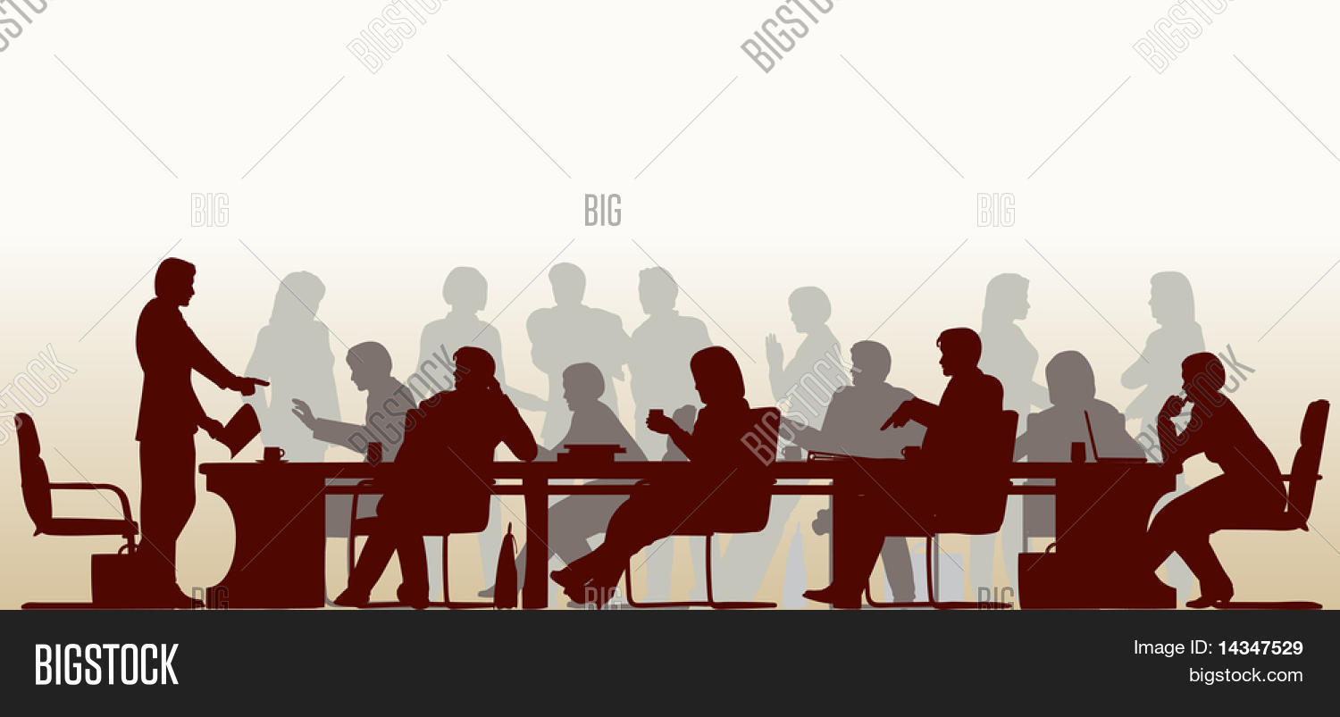 Foreground silhouette of people in a meeting