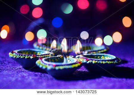 Clay diya lamps lit during Diwali Celebration. Greetings Card Design Indian Hindu Light Festival called Diwali stock photo