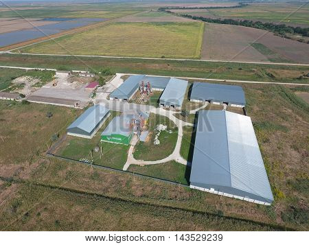 Top view of the hangars. Hangar of galvanized metal sheets for the storage of agricultural products and storage equipment. stock photo