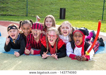 Group of kids in Haloween costumes in a park stock photo