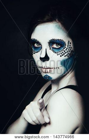 Woman with Halloween Makeup. Sugar skull Beautiful Model. Santa Muerte concept.