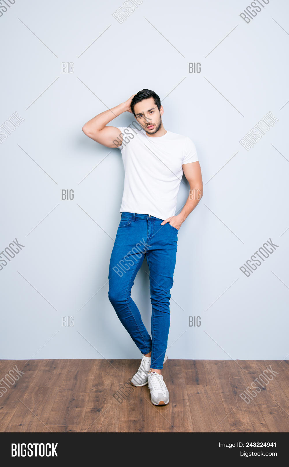 arabic,attractive,bachelor,beauty,boyfriend,bristle,brunet,casual,confident,cool,correcting,diverse,eastern,ethnicity,expression,fashion,fixing,full-length,guy,hair,hairstyle,handsome,harsh,hispanic,hold,jeans,macho,male,man,masculinity,middle,model,muscular,muslim,pants,people,pocket,posing,serious,sneakers,stubble,style,stylish,successful,t-shirt,top,trendy,virile,wall,young