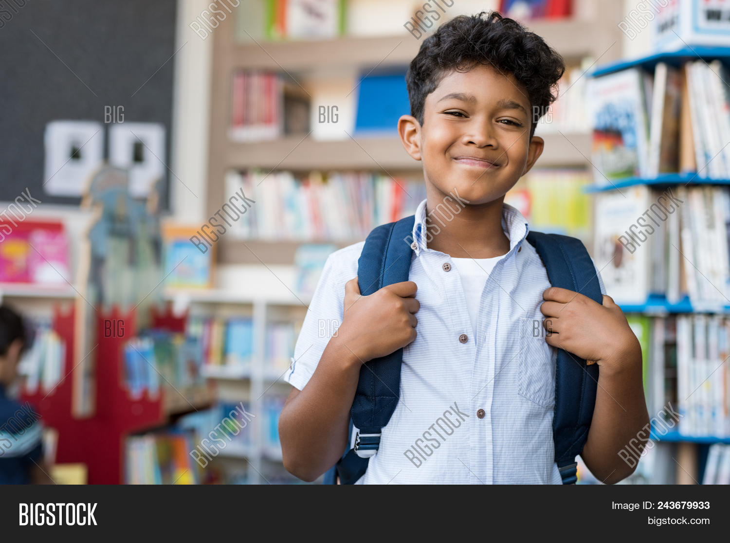 arab,aspiration,back to school,backpack,book,bookshelf,boy,carrying,casual,cheerful,child,class,cute,education,elementary,future,happiness,happy,hispanic,indian,islamic,kid,knowledge,latin,learning,lesson,library,male,middle eastern,multiethnic,muslim,one,portrait,primary,proud,pupil,scholar,school,smile,standing,student,study,studying,textbook,young