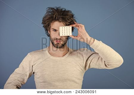 Man face handsome. Health and medicine, hangover. Drug and antidepressant, insomnia. Dieting pill and vitamin, man with anabolic. Cold, flu and headache treatment, hypnotic tablet. Man with pills in blister pack. stock photo