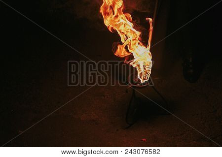 burning torch with flames, amazing fire show at night at festival or wedding party. fire show performance and entertainment. Fire dancers spinning fire stock photo