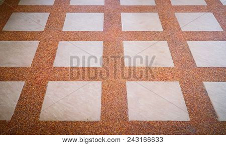 Sand washed brown alternating with white tiling. Brown sandy floor for background stock photo