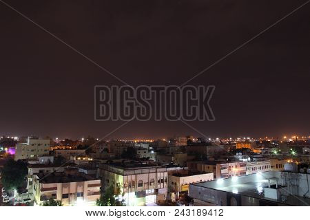 Sunset scene with buildings silhouette in countryside of Jeddah, Saudi arabia stock photo