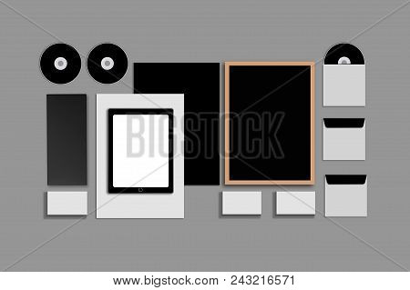 Blank Corporate ID. Set on gray background. Consist of business cards, folder, tablet PC, envelopes, a4 letterheads, notebooks, flash, pencil, cd disk and smart phones. Copy space stock photo