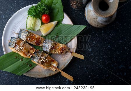 Skewer grilled saba fish with salt set and serve in Japanese style saba shio yaki. stock photo