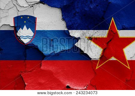 flags of Slovenia and Yugoslavia on a wall stock photo