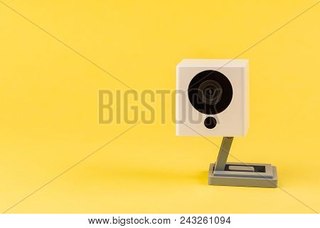 webcam white on a yellow background, object, Internet, technology concept. stock photo