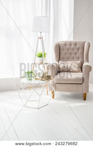 Kind of empty room, table and book, armchair stock photo