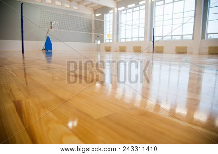Modern new school building. Empty school gymnasium with yellow floor and climbing near walls stock photo