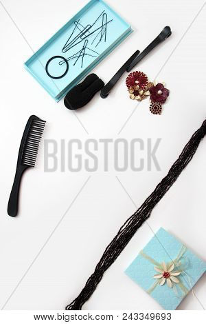 Accessories and hair pins flat lay. Sponge for hair, hairdo babette. necklaces of beads or flowers, tiffany blue boxes made of cardboard. hair comb. White background with copy space for text stock photo