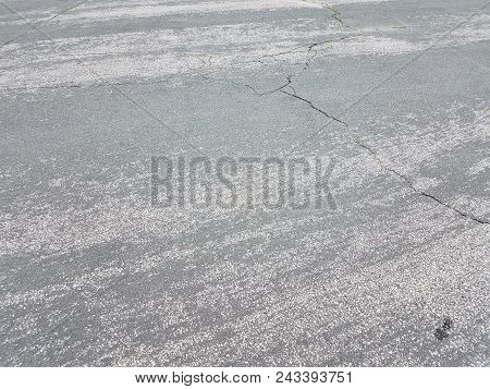 black asphalt street with skid and scratch marks stock photo
