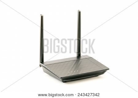 Black Wireless internet network wi-fi Router with two antenna isolated on white background. With clipping path. Design element. stock photo