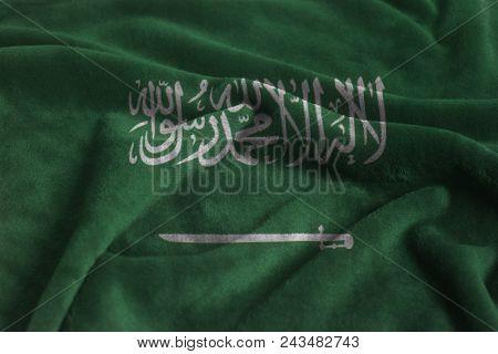 Waving Flag of kingdom of Saudi Arabia on velvet fabric close up. stock photo