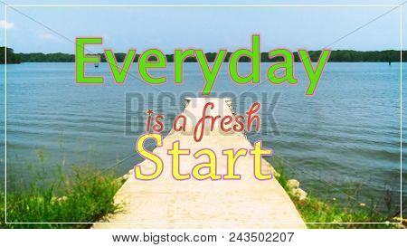 Motivational quotes,Everyday Is A Fresh Start with of jetty at sea facing island during sunny day. stock photo