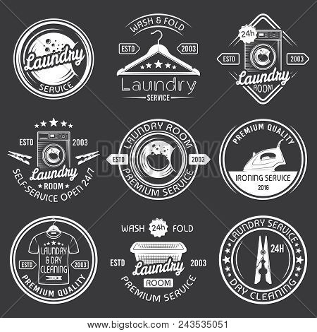 Laundry room and dry cleaning service set of vector white emblems, labels and badges with washing machine, hanger, clothes basket, clothespin, isolated on dark background stock photo