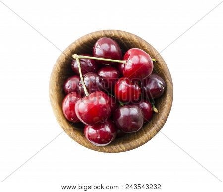 Fresh red cherries lay on white isolated background with copy space. Background of cherries. Ripe cherry on a white background. Cherries with copy space for text. Top view. stock photo