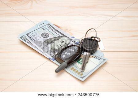 Heap of money and pen. Writer fee. Money dollars, car keys and pen stock photo