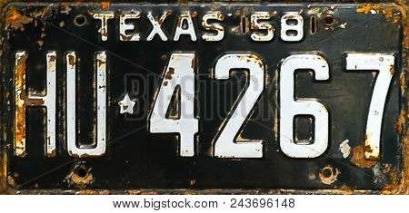 An up close view of a Vintage Rusted Texas 1958 License Plate stock photo