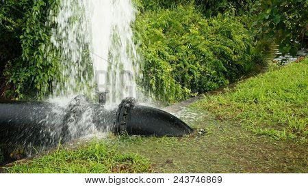 Burst water from main pipeline, Missing water gate valve or stolen stock photo