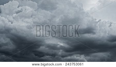 Dark storm clouds before rain used for climate background. Clouds become dark gray before raining. Abstract dramatic background. stock photo
