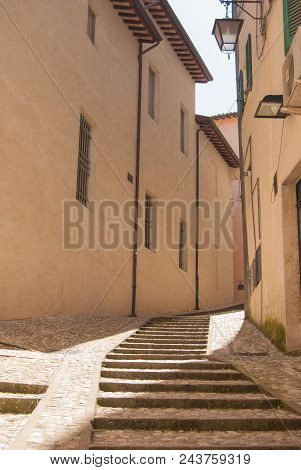 Many rocky steps along a path in a street of the town of Spoleto stock photo