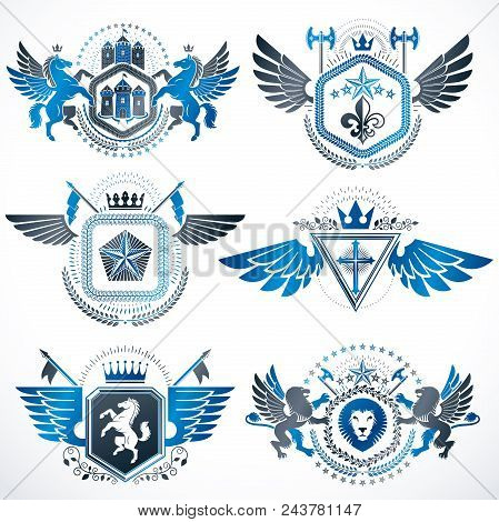 Vintage decorative heraldic vector emblems composed with elements like eagle wings, religious crosses, armory and medieval castles, animals. Collection of classy symbolic illustrations. stock photo