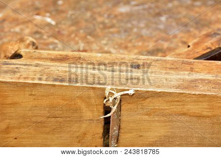 Old primitive tool for wood working and carpentry. stock photo