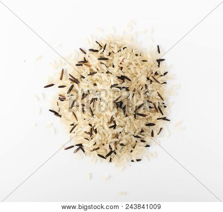 Mix of Raw Black Wild Rice and Parboiled White Rice Top View. Healthy Dietetic Canada Rice Pile stock photo