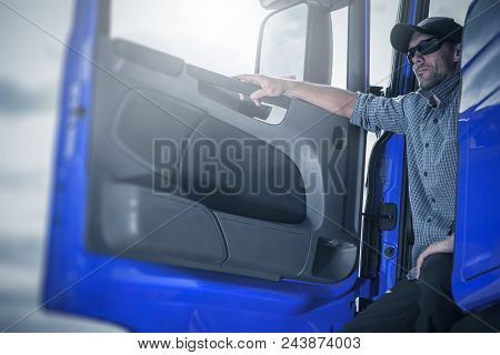 Proud Caucasian Trucker in His Semi Truck Taking Short Break Before Next Shipping Direction. stock photo