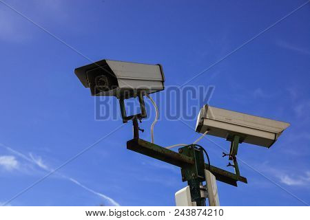 security camera and urban video against blue sky stock photo