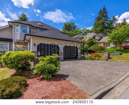 A perfect neighborhood. Houses in suburb at Summer in the north America. Fragment of a luxury house