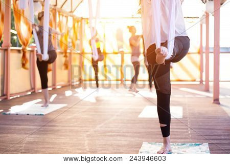 Healthy and fly Yoga Concept. happy smiling girl in a fly yoga class stock photo