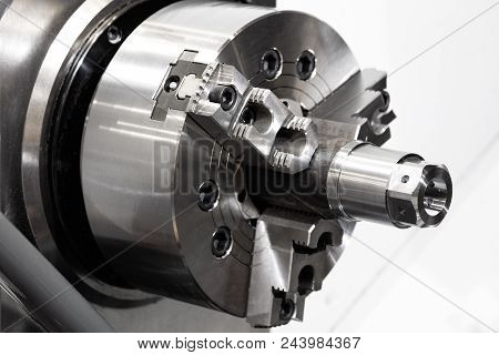 CNC lathe machine or Turning machine with rotating spindle with metal part  industrial engineering concept. stock photo