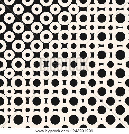 Vector halftone pattern. Geometric seamless texture with morphing round shapes, circles, squares, dots. Diagonal gradient transition effect. Abstract repeat black and white background. Modern design stock photo