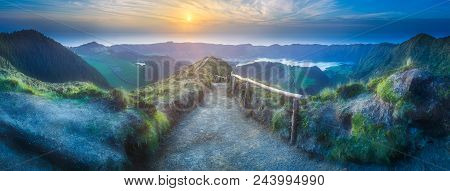 Mountain landscape with hiking trail and view of beautiful lakes Ponta Delgada, Sao Miguel Island, Azores, Portugal. stock photo