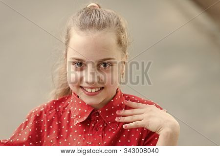 Tender small kid smiling beautiful face. Happiness and joy. Toothy smile. Little child happy smile. Smiling kid with healthy teeth. Adorable girl sincere smiling. Innocence and purity concept. stock photo