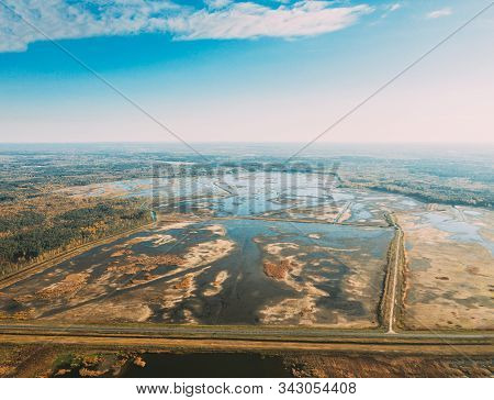 Belarus. Aerial View Of Ponds Autumn Landscape. Ponds of fisheries in the south of Belarus. Top View Of Fish Farms From High Attitude. Drone View. Birds Eye View. stock photo
