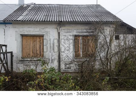 derelict building with boarded up windows. Background stock photo
