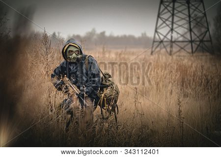 Soldier in gas mask with rifle concept. stock photo