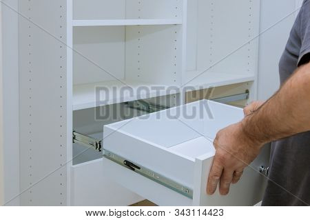 Home renovation room worker box installation the drawer assembling for closet cabinet stock photo