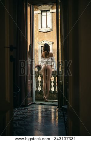 Fashion model in sexy underwear. Beautiful girl with long hair. Advertising and commercial design. Young woman posing. Alone female. Beautiful woman enjoying the freshness. Back view stock photo