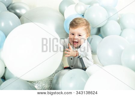 Funny boy. Beautiful smiling child with ballons. Celebrating birstday b-day. Enjoying the moment. Emotions on the face. Adorable baby having fun. Happy moments. Copy space stock photo