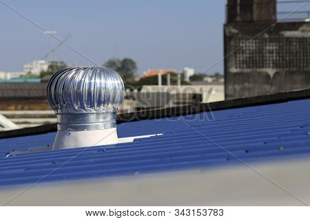 Turbine ventilator installed on the blue roof. Turbine ventilator helps the air to flow at all times. stock photo